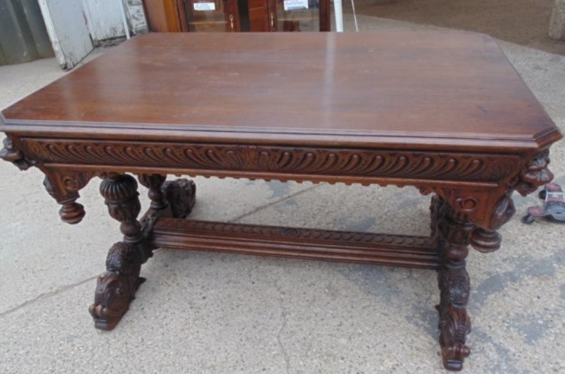 14A FRENCH CARVED OAK LIBRARY TABLE WITH LIONS HEADS