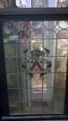 15K18 STAINED GLASS SHIELD WINDOW.jpg
