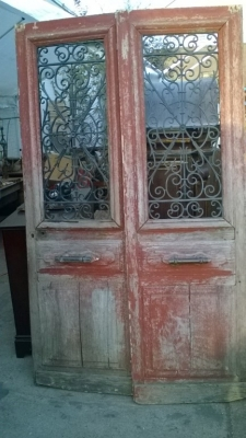 15K19 PAIR OF RED PAINTED DOORS WITH IRON INSERTS.jpg