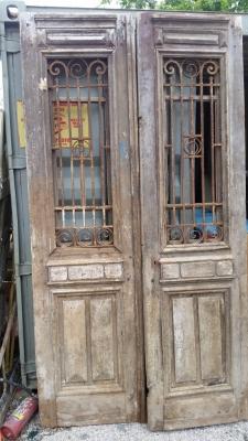 16E08010 PAIR EGYPTIAN IRON AND PINE DOORS.jpg