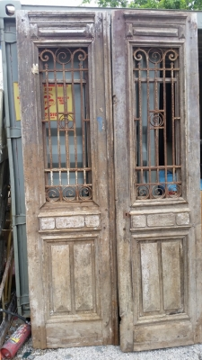 16E08010 PAIR EGYPTIAN IRON AND PINE DOORS.jpg