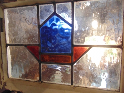 13J09015 LARGE BLUE AND RED GEOMETRIC WINDOW.JPG