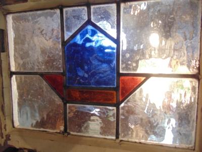13J09015 LARGE BLUE AND RED GEOMETRIC WINDOW.JPG