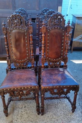 16J05084 SET OF 6 HIGHLY CARVED LEATHER CHAIRS (1).jpg