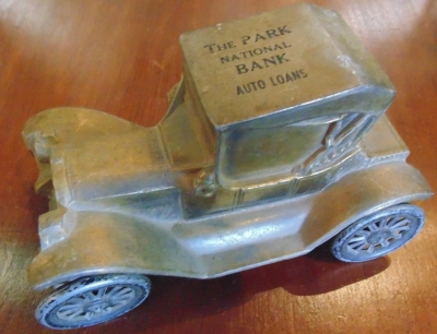 14d21130 toy car bank with advertising.JPG
