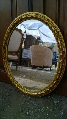 oval gold mirror