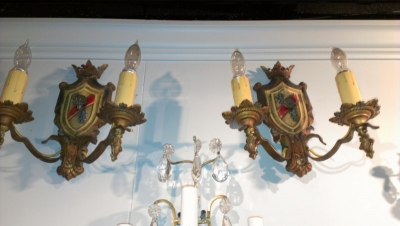 15A23528 PAIR OF SHIELD AND CROWN METAL WALL SCONCES.jpg