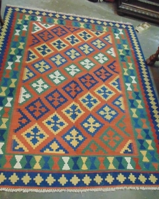 14C24224 GREEN BLUE AND OCHRE RUG