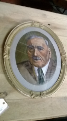 OVAL FRAMED PAINTING OF MAN.jpg