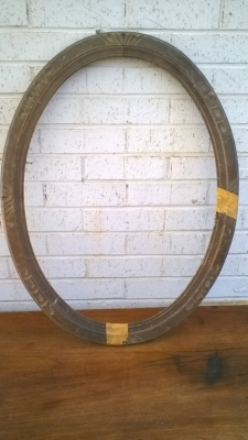 15K24567 CARVED OVAL WOOD FRAME WITH TAPE.jpg