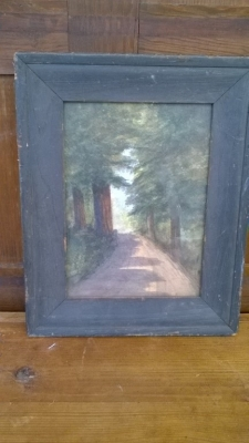 15K24726 BLACK FRAMED OIL PAINTING OF ROAD THROUGH PINE TREES.jpg